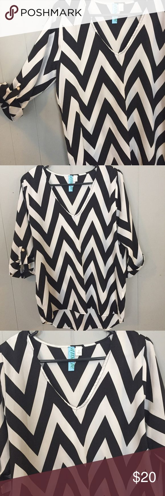 Francesca's black and white chevron blouse Francesca's black and white chevron blouse. ¾ length sleeves with button Pre-owned – great condition. No major signs of wear. Made of 100% polyester Size large Measurements (approximate) Underarm to underarm: 21 inches Shoulder to hem: front – 26 inches – back – 30 inches Francesca's Collections Tops Blouses