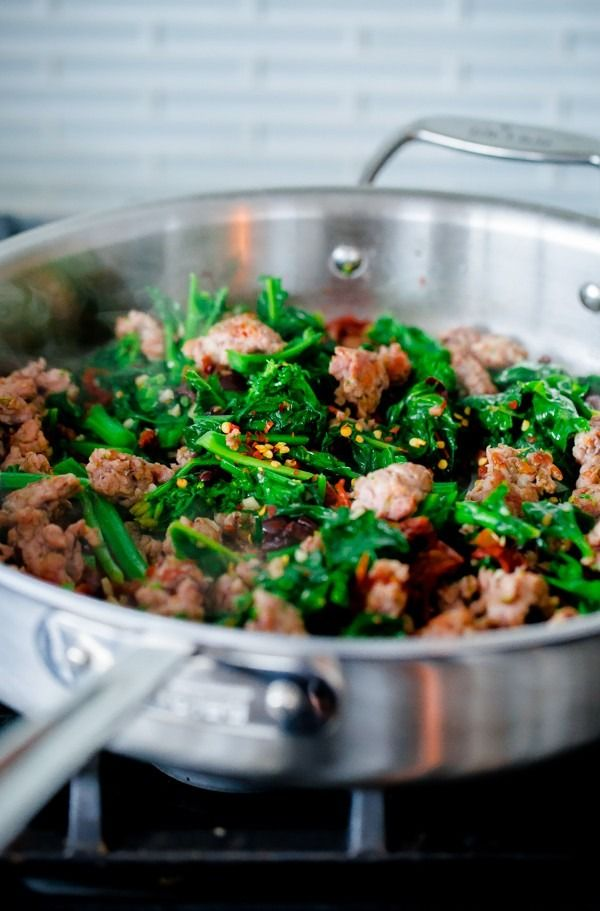 ... with Spicy Sausage, Broccoli Rabe, Sun-Dried Tomatoes, and Olives