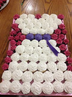For this arrangement we used 57 normal sized cupcakes and about 30 mini-cupcakes. This is done on a full sheet cake board covered in de...