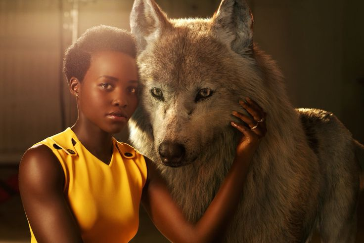 """""""Lupita Nyong'o voices Raksha, a mother wolf who cares deeply for all of her pups–including man-cub Mowgli, whom she adopts as one of her own when he's abandoned in the jungle as an infant. """"She is the protector, the eternal mother,"""" says Nyong'o. """"The word Raksha actually means protection in Hindi. I felt really connected to that, wanting to protect a son that isn't originally hers but one she's taken for her own.""""  #JungleBook"""""""