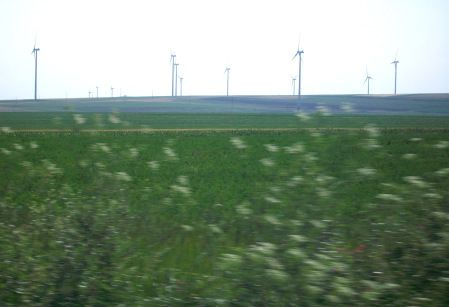 Fields of Wheat and Wind Turbines, Romania at romanianexperience.wordpress.com
