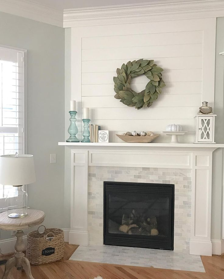 Shiplap and marble fireplace