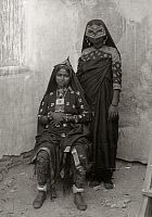 OMAN.   Anklets, earrings, bracelets, nose jewels and veils adorn women. Samuel M. Zwemer.