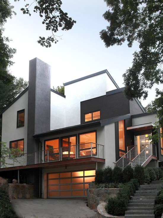 Renovated exterior of a 1980's contemporary style house by Saniee Architects.
