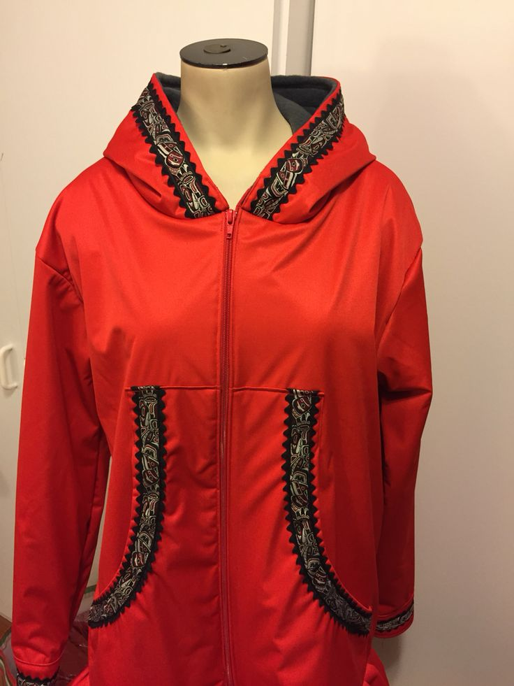 Red waterproof and fleece-lined Qaspeq with double ric rac and Tlingit trim.