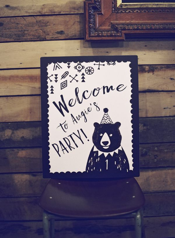 Cute grizzly bear first birthday party, with black and white sign by HipHipHooray.com  Hipster bear in a party hat with geometric prints and a bohemian vibe!  Personalise online with your own text for an instant printable PDF, or get them professionally printed with free shipping.  Party styling by @jessieweddings  Image by @SarahHannamPhotography