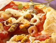 Recette Pizza alla marinara (Pizza aux fruits de mer), notre recette Pizza alla marinara (Pizza aux fruits de mer) - aufeminin.com