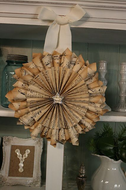 Reloved Rubbish: Vintage Sheet Music Wreaths-The patina on this vintage sheet music adds uniqueness to this beautiful wreath. There is no tutorial, but there are others out there.