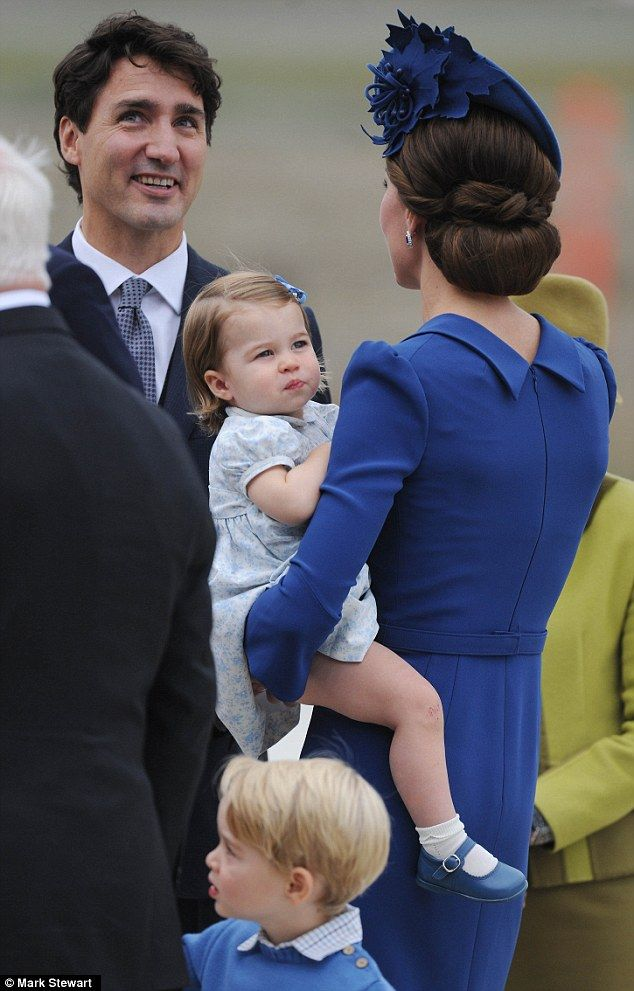 Charlotte wore a pretty patterned white dress with blue shoes and a blue bow in her hair. She clung to her mother during her third public appearance, after appearing to have hurt her knee