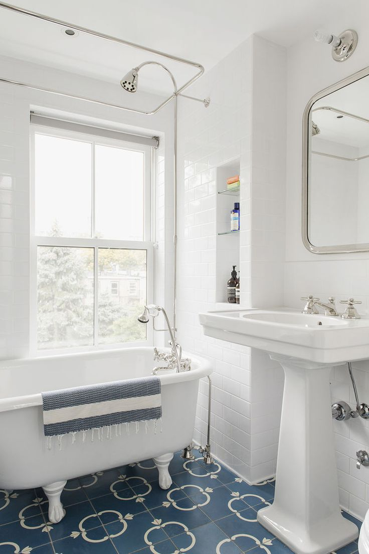 Bathroom with salvaged tub and Waterworks sink in Brooklyn renovation by Elizabeth Roberts.