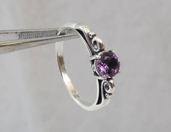 Hey, I found this really awesome Etsy listing at https://www.etsy.com/listing/234489755/alexandrite-scroll-ring-alexandrite