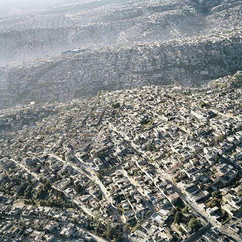 Pablo Lopez Luz (Mexico), a finalist from the professional category, highlights the effect that overpopulation and the chaotic development of a city has on its terrain, land and population with his series 'Terrazo'