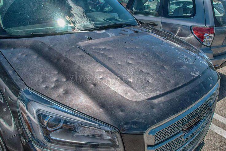 Hail damage to car. Dented car after a big hail storm ,