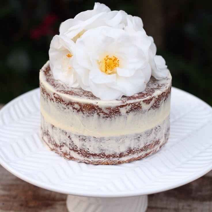 Carmel naked cake covered in vanilla buttercream