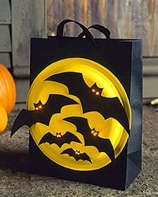 Trick-or-treating Bat Bags: Light up your little ones' night -- and their bags -- with bright-eyed bats. Coat the bottom of a paper plate with bold, reflective paint. Make bats out of construction paper (click here for a template). Create eyes with a 1/8-inch hole punch or nail, first in bats then in plate. Affix bats to plate with craft glue. Stick bulbs from battery-operated LED lights through each eye. Near the bottom of a black paper bag, cut a hole for battery pack to slide through…