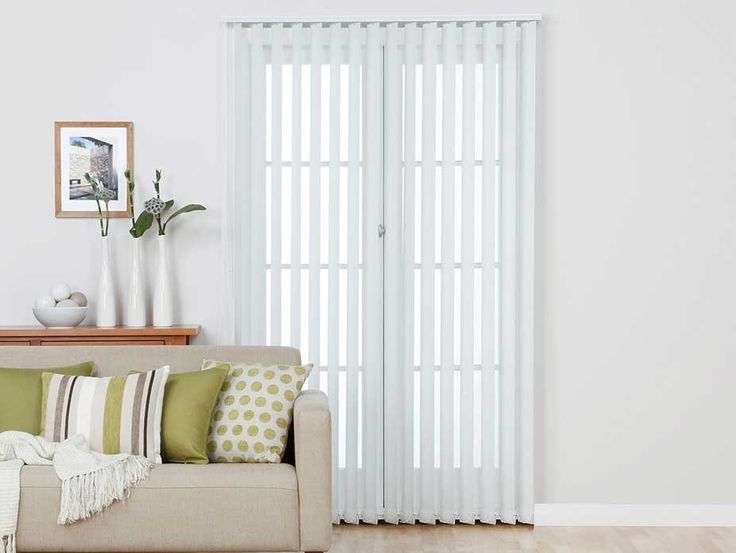 Custom made vertical blinds from Harvey Furnishings. Vertical Blinds visually heighten the room and sit within the window frame. Perfect sun filtering for glass doors without taking any space.