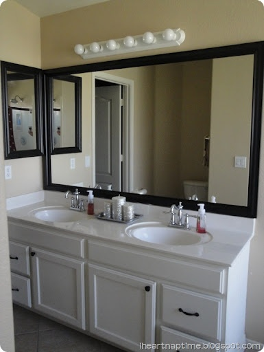 Framed mirror - such a smart idea for those plain old mirrors in most bathrooms