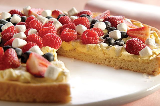Summer berries and mini marshmallows represent the red, white and blue in this scrumptious (and very patriotic-looking) fruit pizza.