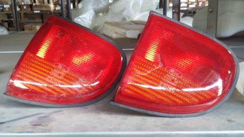 http://produto.mercadolivre.com.br/MLB-717892937-lanterna-traseira-escort-zetec-tampa-lado-esqu-original-_JM