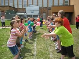 water balloon race -2.  Water Balloon Toss:  Grab a partner and stand across from them.  Toss a water balloon back and forth, stepping further back with each toss.  For a variation, consider catching the balloon in a bowl, bucket, or towel. - See more at: http://ministry-to-children.com/water-games-for-kids/#sthash.5Z86aCdm.dpuf