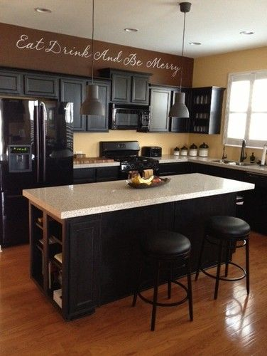 Black appliances with black cabinets - I guess it can be done......