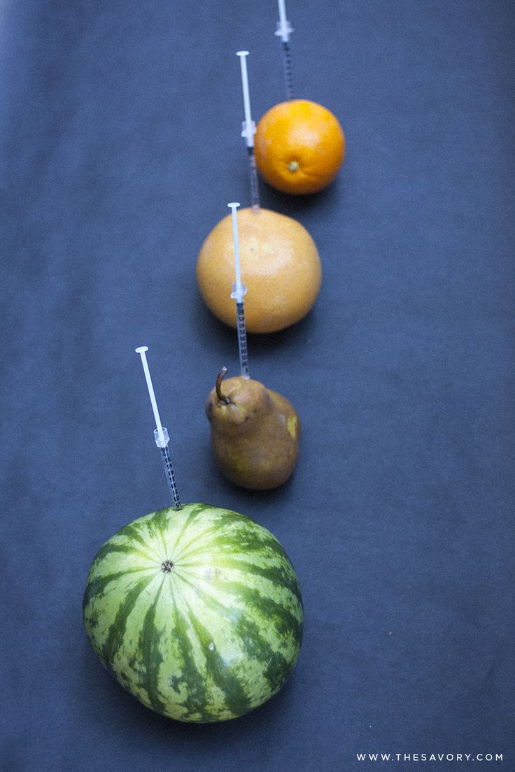 Using syringes to inject fruit with vodka