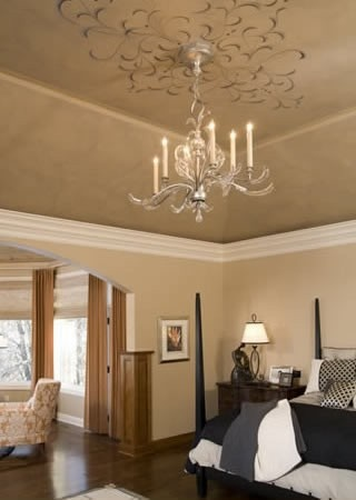 Crown moldings and painted ceiling murals in a vaulted master suite finishes space