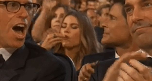 …while Sofia Vergara was snackin' on some popcorn behind him. | 16 Of The Greatest Audience Reactions From The 2015 Emmys
