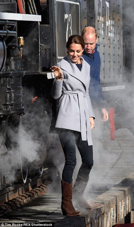 The Duke and Duchess of Cambridge along side train that Queen Elizabeth and Prince Philip visited in 1959. Catherine beautiful gray sweater, hair worn in low bun. cute pose, boots. steam Kate looks awesome. I think this photo is so fantastic.