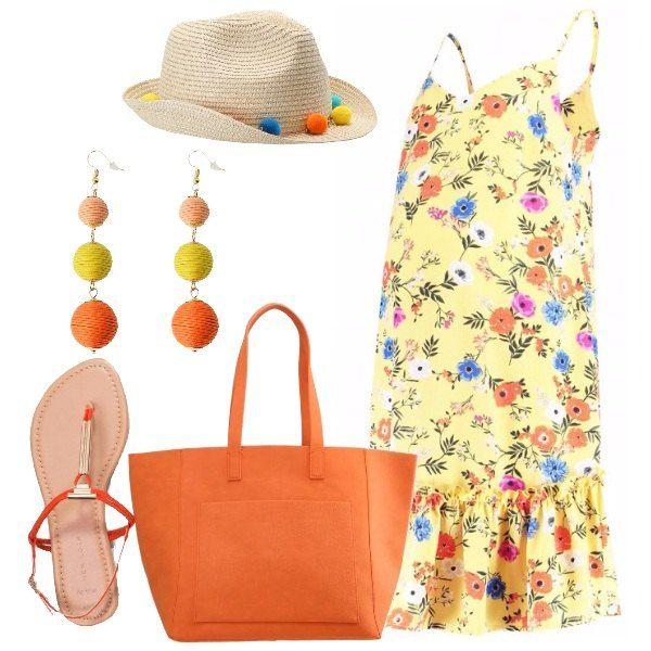 Outfit colorato e leggero, i colori principali sono quelli solari e allegri per eccellenza: giallo e arancio. Il vestitino con spalline ha sfondo giallo e tanti fiori colorati, i sandali infradito sono arancioni, come l'ampia borsa shopper. Gli accessori: cappello con pon pon colorati, come gli orecchini.