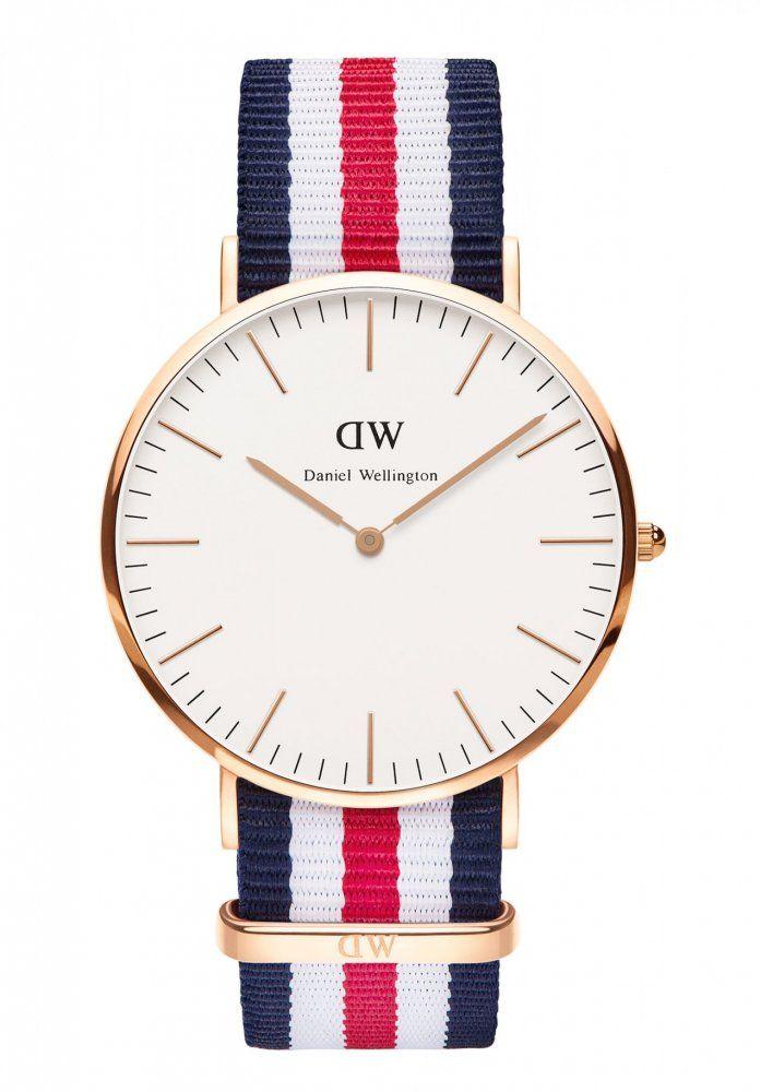 Daniel Welington 0102DW Módní pánské hodinky Daniel Wellington s textilním pruhovaným páskem a pozlaceným ocelovým pouzdrem. Vodotěsné do 30M.