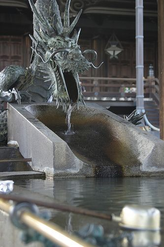Before entering any shrine you wash your hands. We saw fountains for this that ranged from simple to elaborate. This was my favorite one, at Nishi Honganji in central Kyoto.    Kyoto, Japan, March 2004