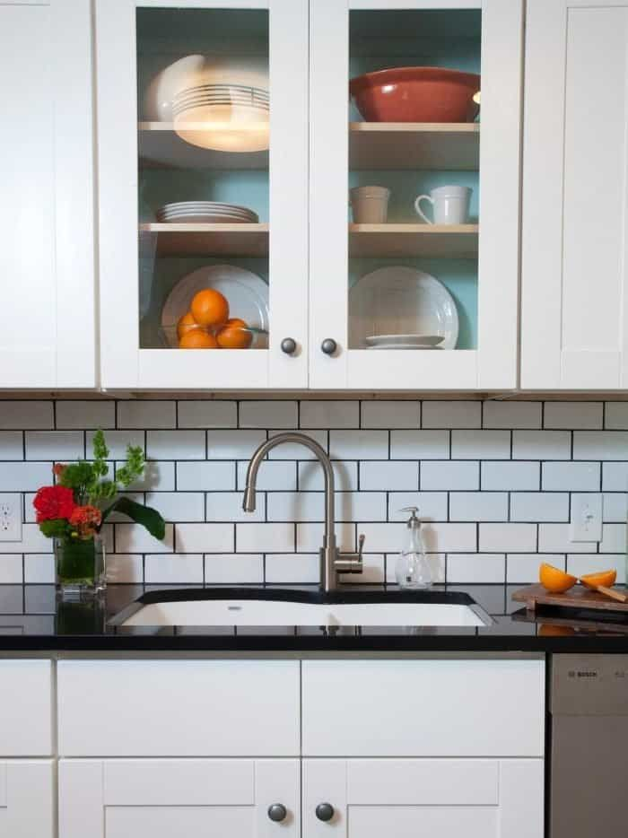 Kitchen With White Subway Tiles And Undermount Sink
