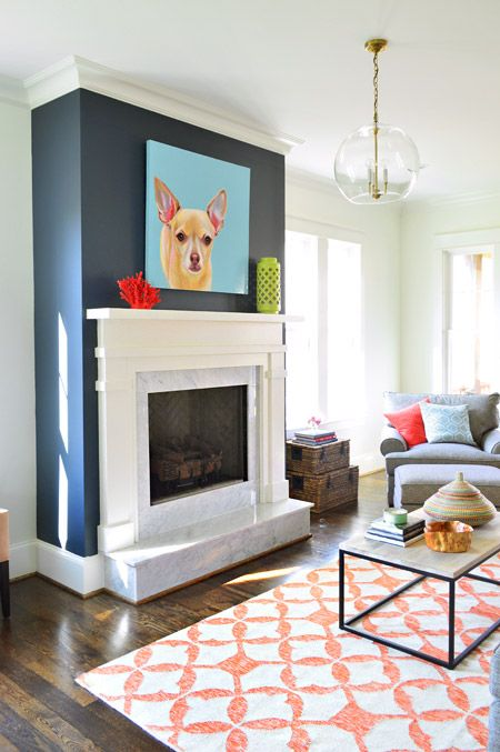Blue accent wall with fireplace. Young House Love | The Heart of The (Show) Home | http://www.younghouselove.com