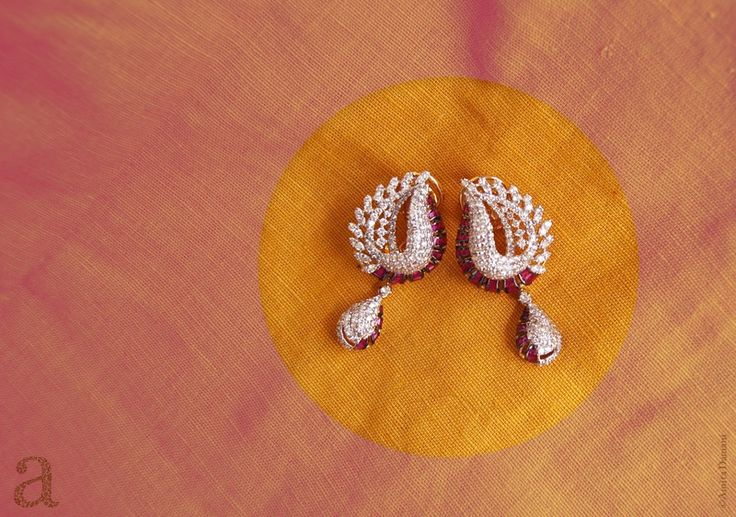 Indian Jewellery and Clothing: Exclusive designs of earrings by Amita damani who is making miracles with rubies,emeralds,sapphires,pearls and diamonds..
