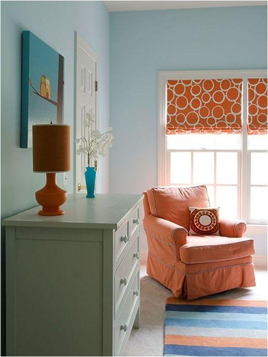blue and orange nursery - orange geometric curtains, striped rug, sage painted dresser