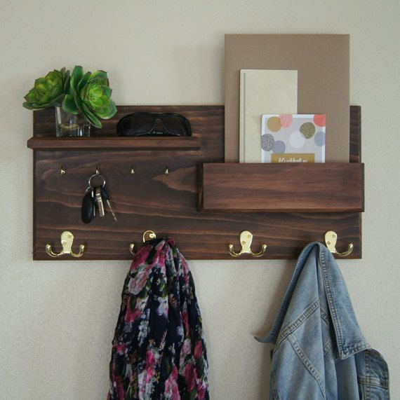 Keep your home stylishly organized with this coat rack, a Midnight Woodworks original design. Our handcrafted entryway organizer is an excellent entryway storage solution. Perfect for mail, keys, coats, backpacks and other necessities! This custom built flush-mount one-shelf organizer is made using solid wood stained Java but can be custom ordered, see photo #5 for options. Four polished brass double coat hooks provide storage for your bags, backpacks and other necessities...and theyre…