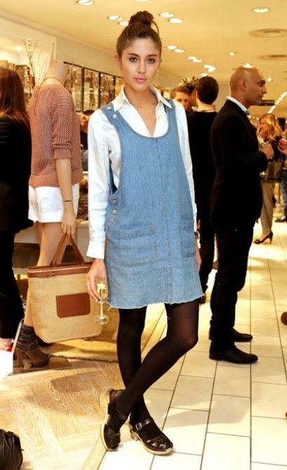 Quentin Jones teams a denim pinafore with a white shirt for an effortless but stylish look.