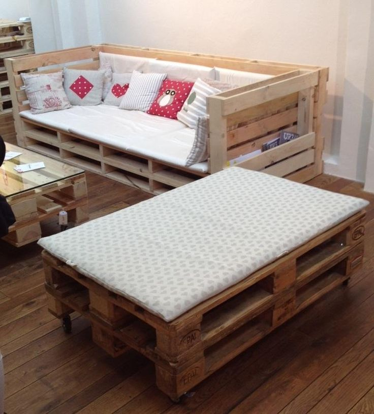 Pallet furniture. Outdoor loveseat and bench. Built -in magazine racks.