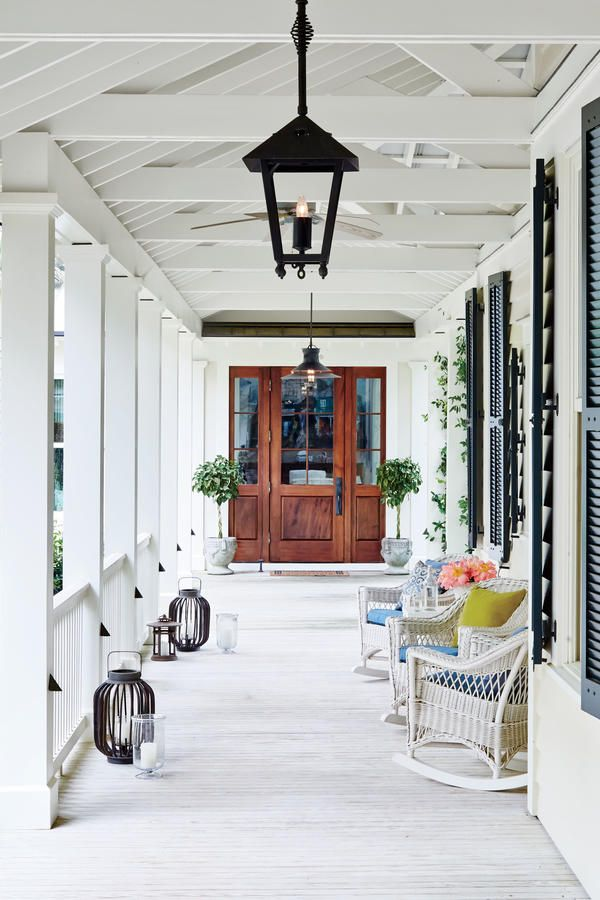 Breezy Entry - South Carolina River House Tour - Southernliving. Rather than a grand entry hall, the welcoming element here is a 113-foot-long, tongue-and-groove pine breezeway that leads to the main cottage and unites the four buildings. The Shaker-style front door is mahogany with paneled sidelights.