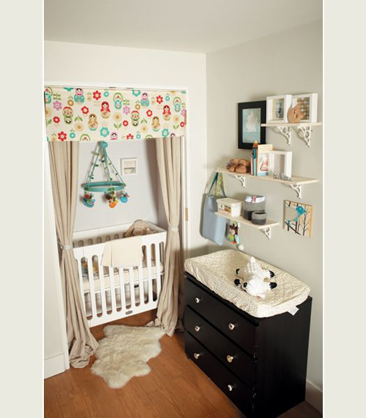 Nursery in the corner of a bedroom, with the closet doors removed and curtains up for a crib nook.