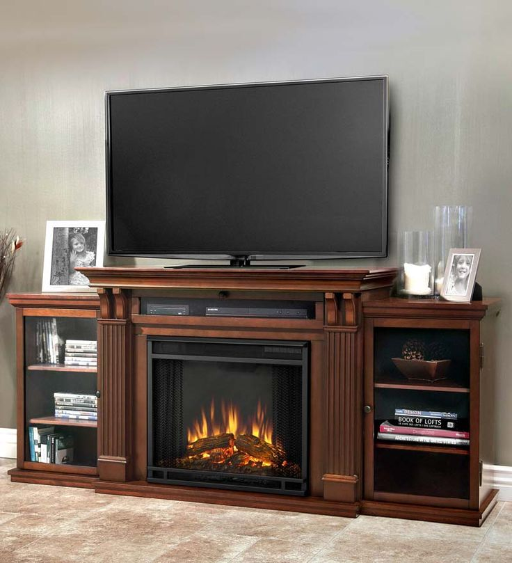 Ashley electric fireplace entertainment center for the for Bedroom electric fireplace