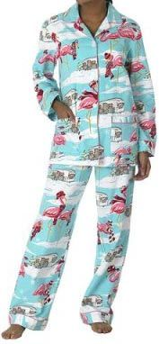 The Nick & Nora turquoise flannel flamingo pattern features pink flamingos bundled up in scarves, hats, and earmuffs and surrounded by snowdrifts, snowflakes, and Airstream trailers strung with Christmas lights. (Oh yeah, I had these pajamas. lol)