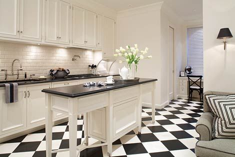 I adore the subway tile backsplash and black and white floors here.