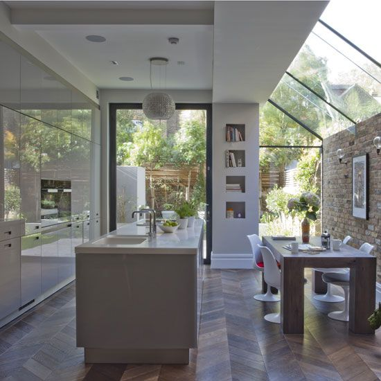 White , modern kitchen , glass extension , pivot door , oversized window, Saarinen Tulip chairs , decorative extractor , island