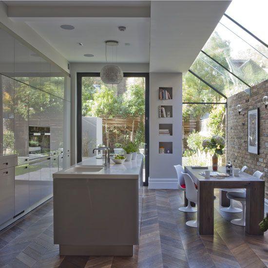 White , modern kitchen , glass extension , pivot door , oversized window, Saarinen Tulip chairs , decorative extractor , island