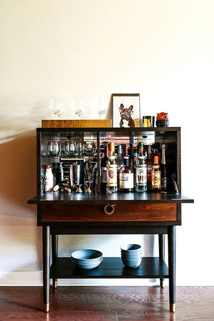 The Easiest Way To Keep Your Home Party-Ready — All The Time #refinery29  http://www.refinery29.com/homepolish/7#slide-2  When your frat-bro friends come over to drink cheap beer, you can close this bar to hide your fancy, carefully researched liquor and bitters collection. We all have alter egos.