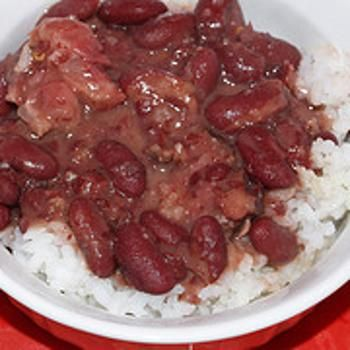 RED BEANS and RICE Popeyes Copycat Recipe  Serves 8   1 lb dry small red beans 1 1/2 to 2 lbs meaty ham shanks 4 cups water 4 cloves garlic, minced 1 large onion, chopped (about 2 cups) 1 1/2 cups chopped celery 1 cup chopped green bell pepper 1 tablespoon Worcestershire sauce 2 teaspoons of Cajun or Creole seasoning (Tony Chachere's or Zatarains) Tabasco sauce salt and pepper to taste cooked white ric