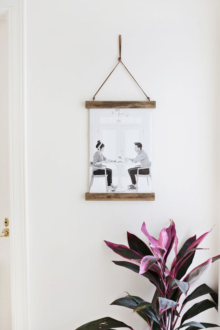 I am forever hunting for simple, unique solutions for hanging large photos. These gold corner frames are my favorite so far. Otherwise I've been a little noncommittal about hanging photos up until thi