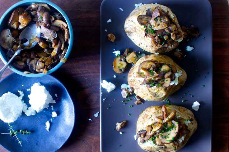 baked potatoes stuffed with wild mushroom ragu  -  butter, onion, garlic, mixed mushrooms, salt, pepper, white wine or vermouth, broth, herbs, chives, goat cheese.  sounds good, want.     lj